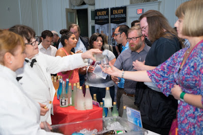 Sake flowing from Sake Fest 2014. Image courtesy of 750 Media