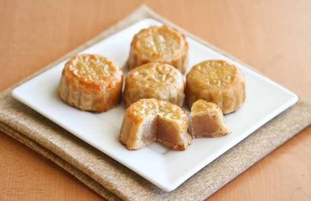photo of mooncakes with one cut open to show the inside