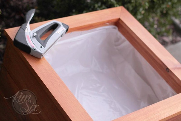 Lining flower box with plastic