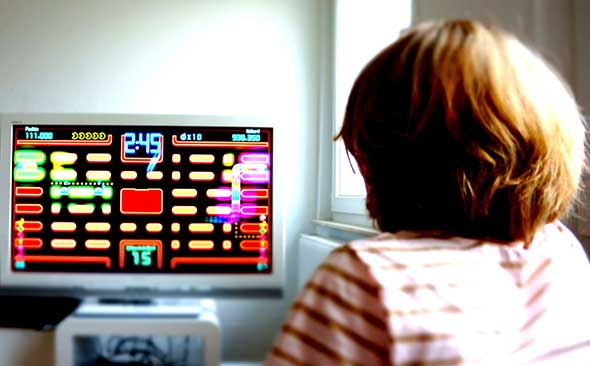Girl plays Pac Man