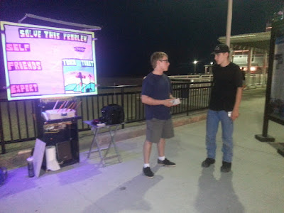 This is JT on the right talking with Wes. JT is a very open young man who we met last year at the beach! He stayed with us the whole night talking and asking questions and even gave out gospel tracts with us. I've been in touch with JT via email and he began attending a church I recommended to him. Please keep JT in your prayers!