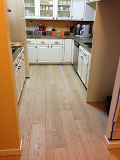 raw floor in kitchen