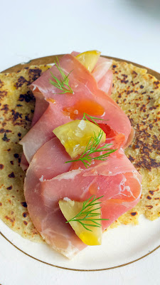 A plate of lefse with ham, brie and tumeni pickles from the menu at Maurice