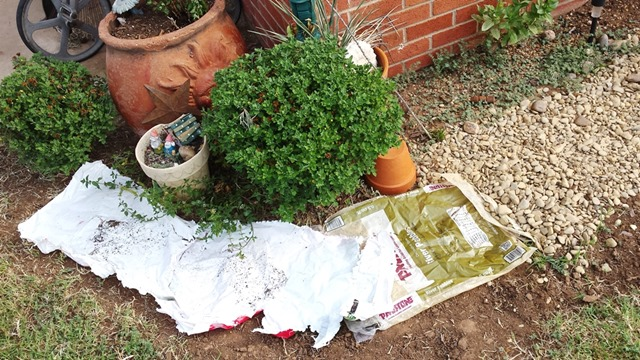 use plastic bags as weed barrier for dry river bed