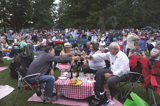Ken and Robin Koval and Diane and Arthur Provenz toast to friendship at Tanglewood, 2014. Photo courtesy Arthur Provenz. From The Tanglewood Picnic: Music and Outdoor Feasts in the Berkshires