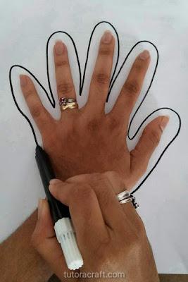Desenhando uma mão com uma caneta