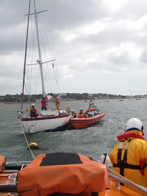 22 May 2011 – ILB and ALB crew onboard grounded yacht preparing tow ropes, (1) on yacht's halyard for ILB and (2) astern of ALB