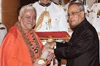 The President, Shri Pranab Mukherjee presenting the Padma Shri Award to Jagat Guru Amrta Suryananda Maha Raja, at a Civil Investiture Ceremony, at Rashtrapati Bhavan, in New Delhi on April 08, 2015.
