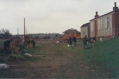 The Young Farmers put the spade and fence post bumper to good use. The trees are a bit bigger now!  Date: February 1994.   Photo: Geoff Peacock?