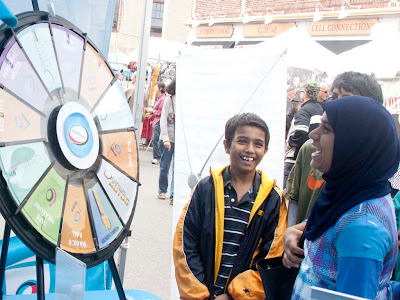 Fawaz Khan of Randolph (whose grandparents live in Teaneck) enjoying optimum's prize wheel.