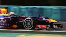 Sebastian Vettel racing his Red Bull RB9