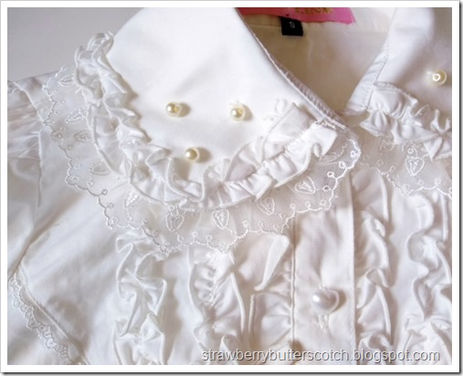 Close up of the collar of the blouse.  You can see that the faux pearls on the collar do not quite match the pearl heart buttons down the front.