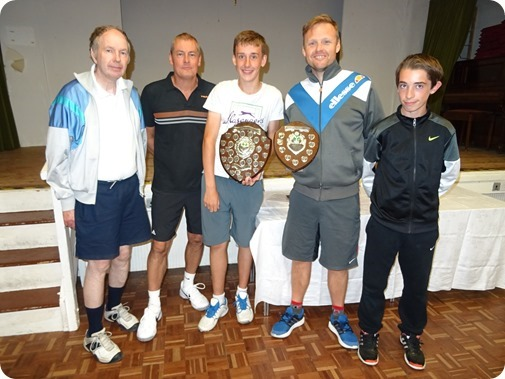 Wistaston A captain George Raiswell (centre) with his  winning players and their two shields
