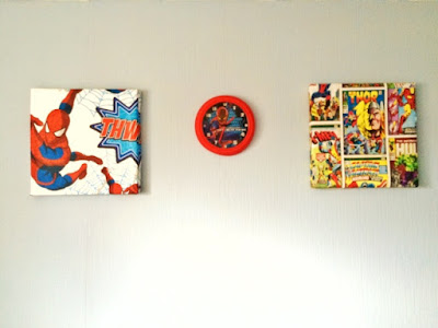 Plain wall with two marvel canvases and spider man clock