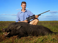 Perryn with a huge wild boar at Carmor Plains. This boar has it all.... great tusks and big in the body. He would weigh in at 120kg+