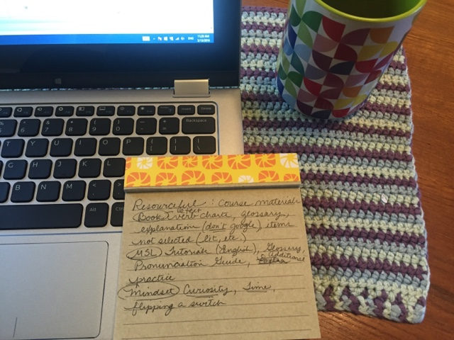 Picture of laptop, coffee mug and notepad with list of ideas to represent the writing strategy of lmaking a list