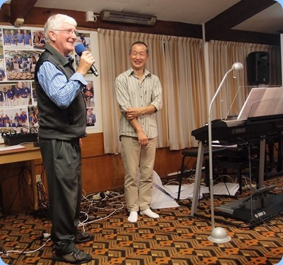 President, Gordon Sutherland, thanking our guest artist, Taka Iida, for a wonderful concert. Photo courtesy of Dennis Lyons.