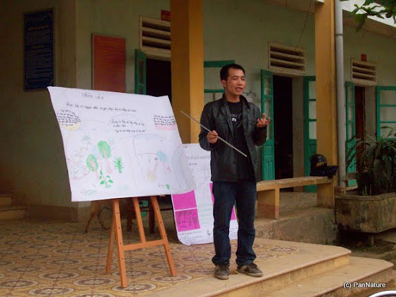 Dau Ngoc Cong, PanNature's EE Program Assistant, presenting about Khau Ca forest and the Tonkin Snub-nosed Monkey at a school session.