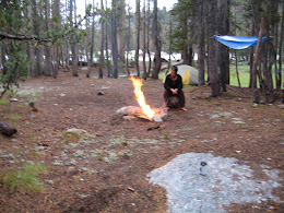 Stoking the fire after the storm came through.