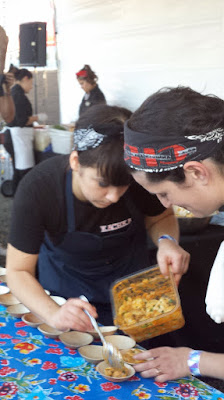 Bonnie Morales of Kachka preparing plates of Lamb Pelmeni with Adjika Butter and Pickled Pears