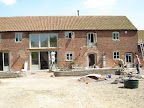 Assorted flush casement  windows and doors for a listed barn conversion