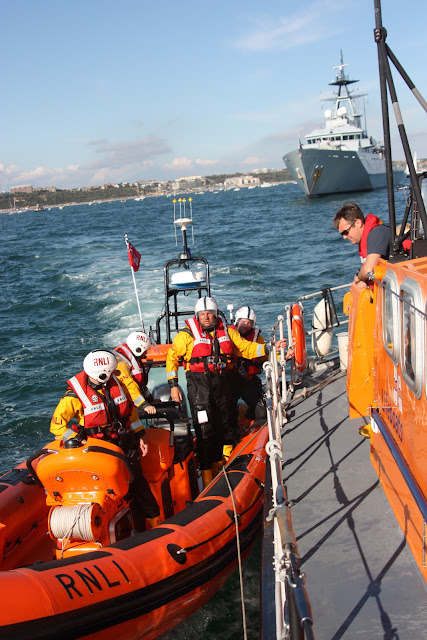 ILB and ALB alongside tow practice. 21 August 2011. H.M..S Tyne in the background.Photo:RNLI Poole/Ade