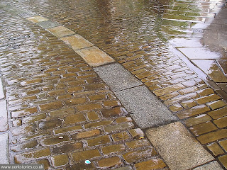 2007, on a rainy evening. Cart tracks and setts in King's Square