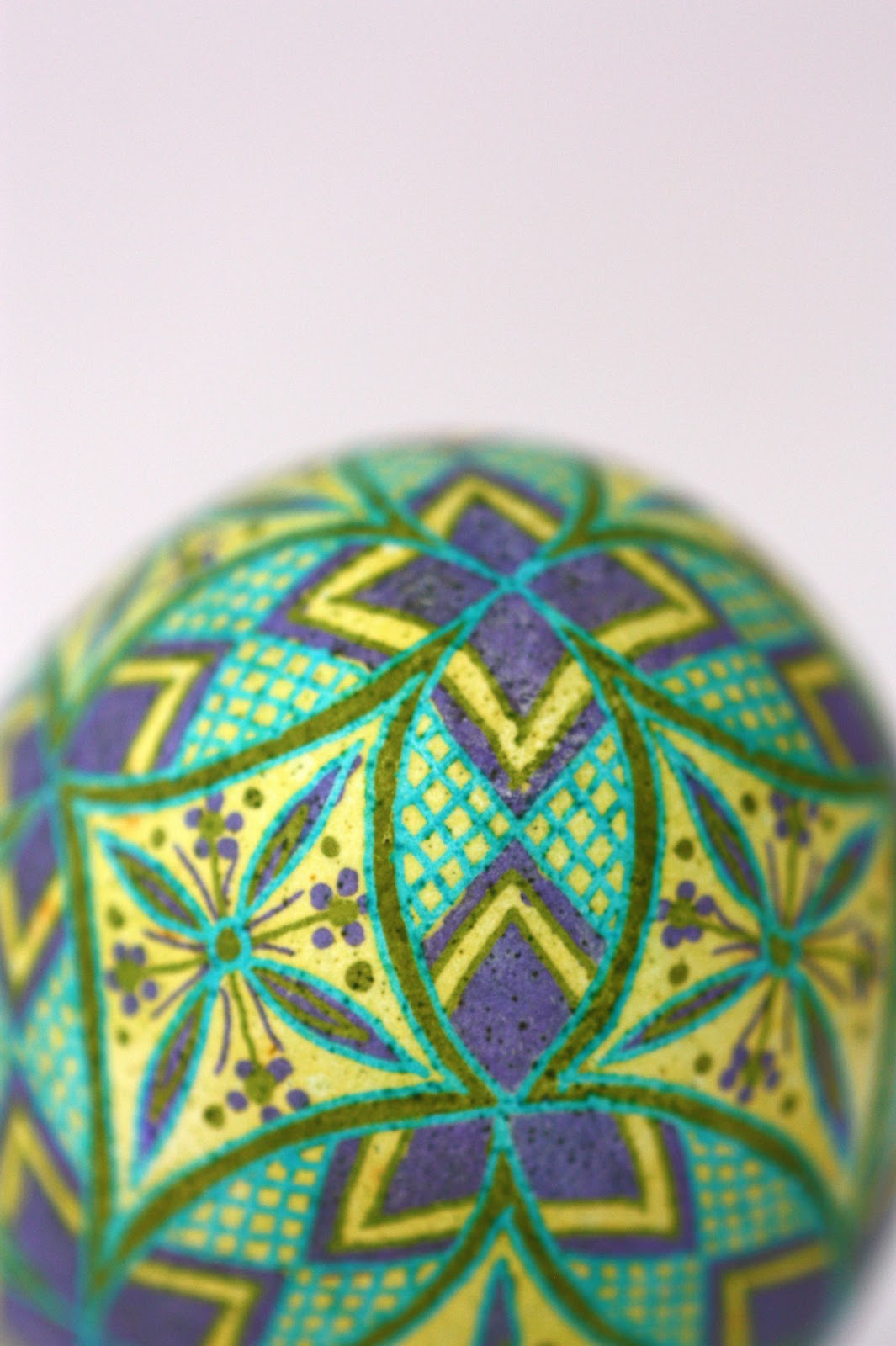Pysanky Easter Egg with round geometrics in purple, yellow, green and blue
