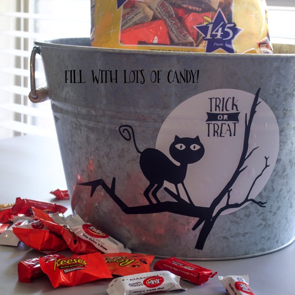 DIY a Halloween candy bucket! Simple instructions on using vinyl and your cutting machine!
