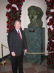 Judge Whitley stands near more art given the festive treatment at The White House.