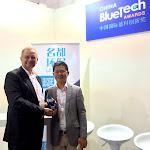 "Jean-Louis ""JL"" Kindler poses with Stephen Jan, OriginClear Hong Kong, and the Blue Tech Award"