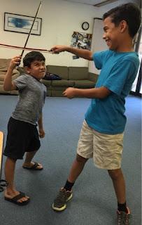 Students use violin bows as swords