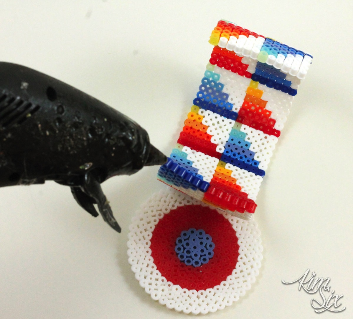 Glue gun on pearler beads to make 3D