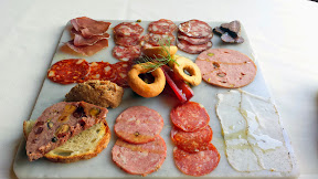 Higgins Restaurant- Charcuterie board of artisanal cured meats and pickles