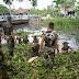 Cegah Banjir, Anggota Koramil 04 / Babelan Kodim 0509/ Kab Bekasi Berlomba - Lomba Bersihkan Eceng Gondok di Aliran Kali Dt 8 wil Buni Bakti