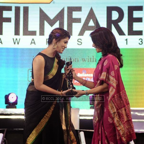Amala Akkineni presents the Best Actor Award for female in Tamil to Nayanthara for her performance in the film 'Raja Rani' during the 61st Idea Filmfare Awards South, held at Jawaharlal Nehru Stadium in Chennai, on July 12, 2014.