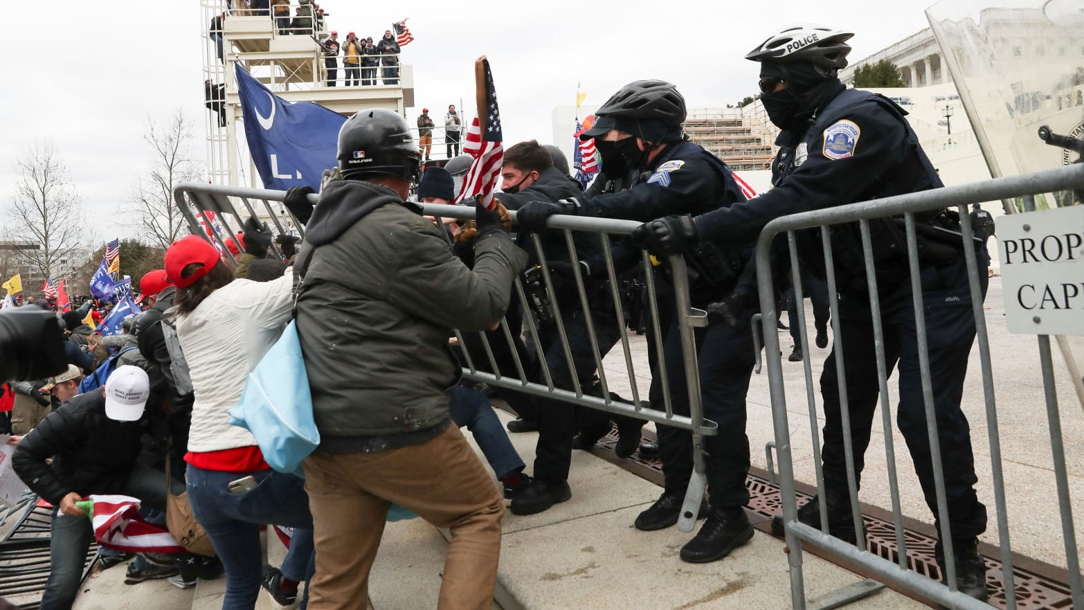 Donald Trump supporters clash with police as they attempt to gain access to the U.S. Capitol building ahead of Joe Biden's election certification (Watch videos)