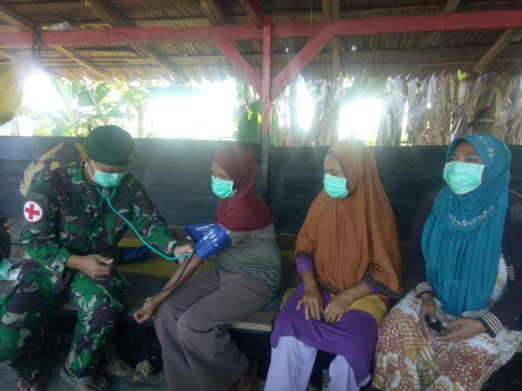 Satgas Yonarmed 9 Lakukan Penertiban Penggunaan Masker di Desa Waci