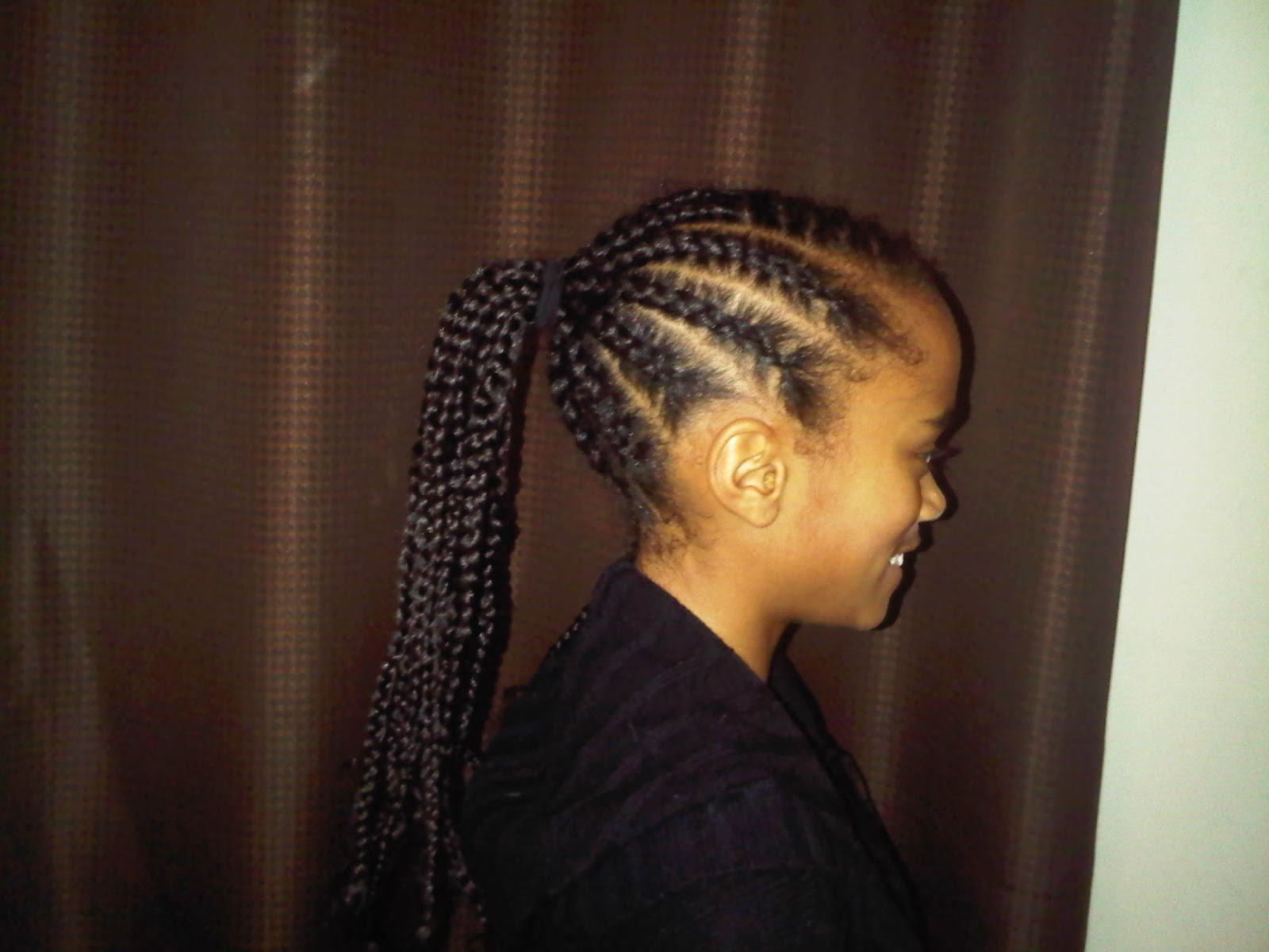 center of the back of her head i pulled the cornrows into a ponytail ...
