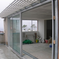 Installing Stacker Doors Leading to Terrace