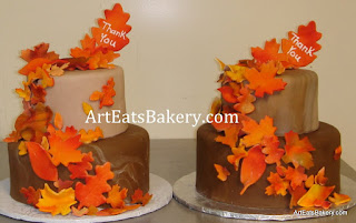 Two tier brown fondant thank you cakes with fall colored sugar leaves