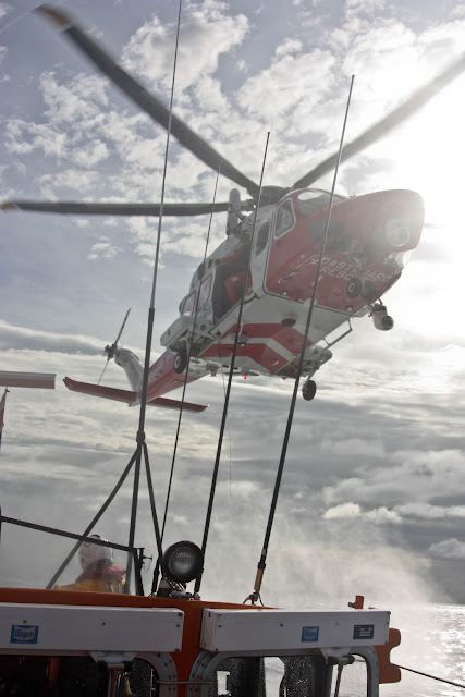 9 October 2011. Portland helicopter overhead Poole lifeboat during a training exercise. Photo: Poole RNLI/Ade