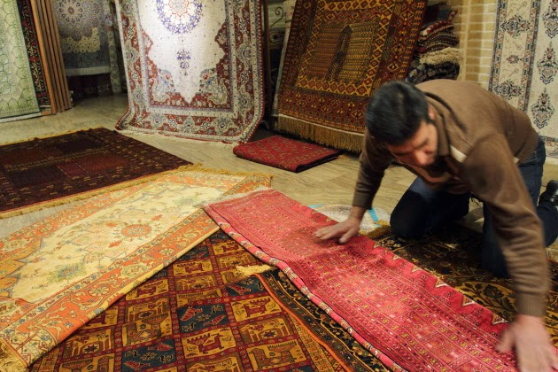 Carpets to choose from at the grand bazaar of Isfahan, Iran