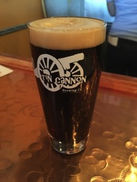 An eight-ounce beer glass filled with dark ale