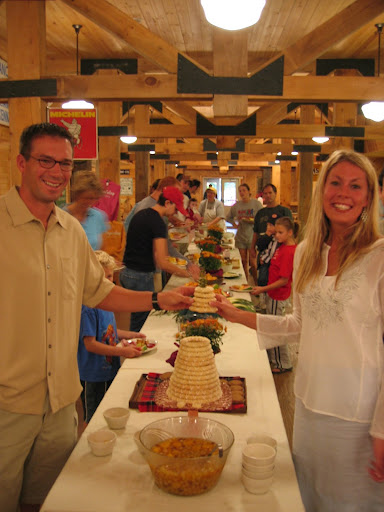 """Lifting the rings from the Norwegian wedding cake, """"kransekake"""" a tradition at Maplelag on Sunday mornings of wedding weekends."""