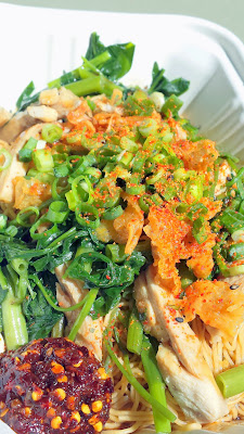 Mii Gai, egg noodles with housemade sweet and savory Mii sauce topped with chicken, ong choy, fried garlic/shallots, scallions and crispy chicken skin from Haan Ghin, a Laotian Food Cart in Portland