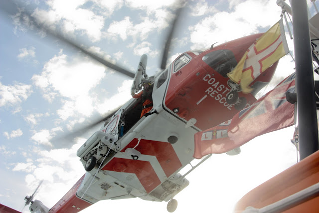 9 October 2011. Portland Coastguard helicopter overhead the Poole lifeboat 'City of Sheffield'. Photo: Poole RNLI/Ade