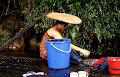 Doing the washing beside the Melinau river at Long Pala