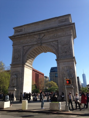 The Arch at Washington Square was modeled after the Arch de Triomphe in Paris;  Freedom Tower in the Background