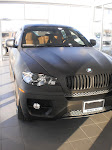 2010 BMW X6 - full matte black wrap done at Budd's Dealership in Hamilton